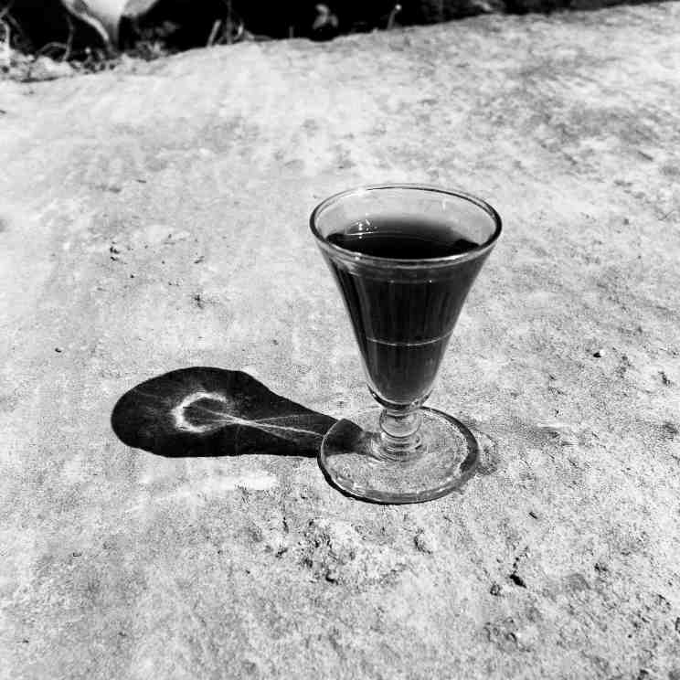 Bill Culbert, Small Glass Pouring Light, 1979, black and white photograph, 41.5x41.5cm