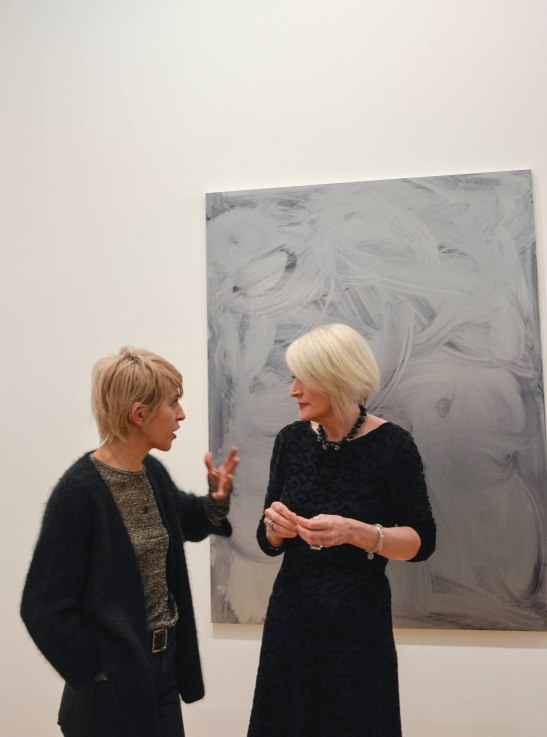 Andrea Medjesi-Jones and Clare Bradley during the private view night. In the background, Jack Brindley's work.