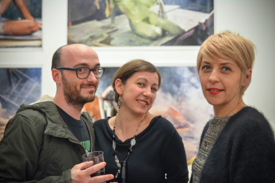 Eleonora Raspi and Andrea Medjesi-Jones in front of Stefan Ruitenbeek's photographic prints